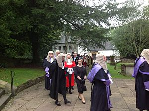 Recorder (judge) - Eleri Rees, the Recorder of Cardiff (red robes), at a ceremonial event with circuit judges (purple robes)