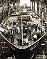 Liberty Ship hull being cleaned up for launching ceremony, WWII (26248526764).jpg