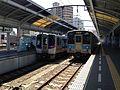 "Limited Express ""Uzushio"" and train for Takamatsu Station stopping at Takamatsu Station.JPG"