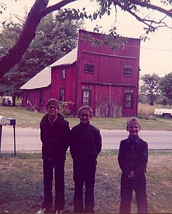 Author Lorin Morgan-Richards (on right) as a child with his brothers in Beebetown, Ohio. The old blacksmith shop (no longer standing) is seen in the background.