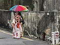 Malacca Malaysia Colourful-Two-ladies-with-umbrellas-01.jpg