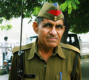 Uttar Pradesh Police - A constable of Uttar Pradesh (U.P.) Police wearing the traditional garrison cap.