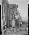 Manzanar Relocation Center, Manzanar, California. Evacuees of Japanese ancestry are enjoying postal . . . - NARA - 536853.tif