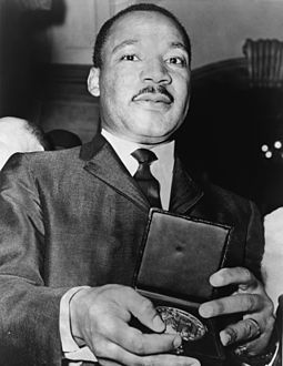 King showing his medallion, which he received from Mayor Wagner Martin Luther King Jr with medallion NYWTS.jpg