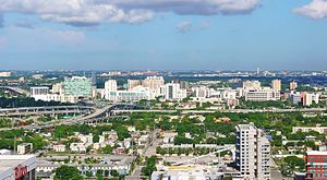 View westward of the Health District, with the Midtown Interchange foreground and Miami International Airport right-background