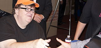 Michael Moore - Michael Moore (left) at Royce Hall, UCLA to promote his memoir Here Comes Trouble, September 2011
