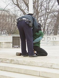 Anti-war activist Midge Potts is arrested for civil disobedience on the steps of the Supreme Court of the United States on 9 February 2005