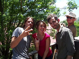 Miley Cyrus and crew members on set of Hannah Montana The Movie