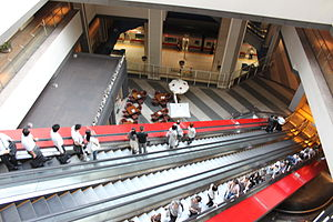 Minatomirai Station - Escalators down from Queen's Square to platform level of Minatomirai Station in September 2011