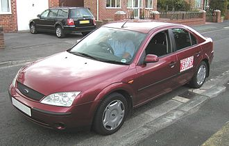 Taxicabs of the United Kingdom - A Ford Mondeo UK private minicab with company name and telephone number on each side