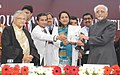 """Mohd. Hamid Ansari releasing the Annual Report of """"Institute of Liver and Biliary Sciences (ILBS)"""" at its """"3rd Foundation Day function, in New Delhi. The Chief Minister of Delhi, Smt. Sheila Dikshit is also seen.jpg"""