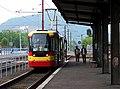 Most, nádraží, tram 314 - Vario LF v nástupní zastávce.jpg
