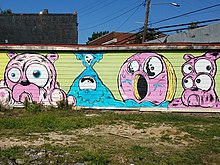 Mural by Ray Geier in East Atlanta featuring a doughnut and French Bulldogs