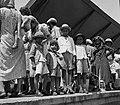NEW IMMIGRANTS FROM YEMEN WAITING AT THE HAIFA TRAIN STATION FOR THEIR TRANSFER TO THE ATLIT RECEPTION CAMP עולים חדשים מתימן ממתינים בחיפה לרכבת המגיD597-023.jpg