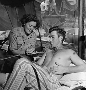 Canada in the Korean War -  Norwegian Captain Petra Drabloe is shown with a patient, Lance Corporal M. R. Stevens of North Bay, Ontario
