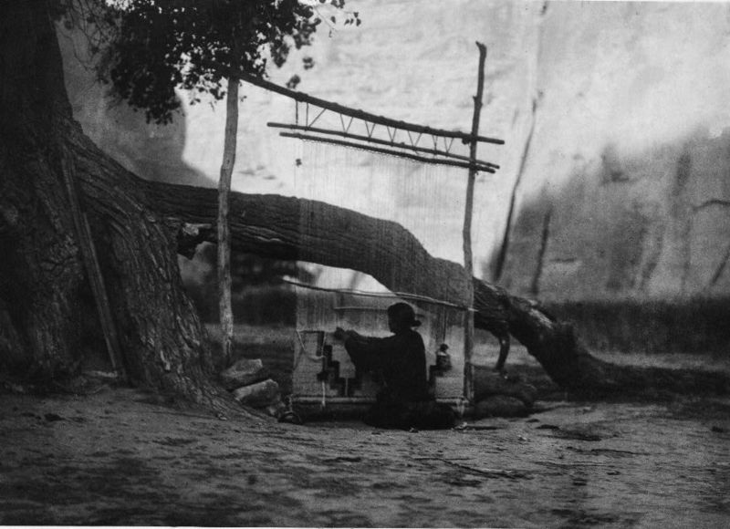 Navajo weaver at her outdoor loom by E.S. Curtis, 1907