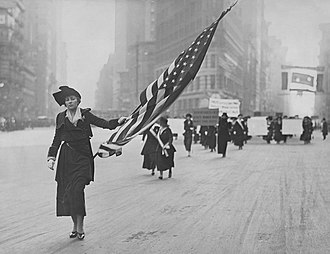 Neysa McMein - Neysa McMein carrying the flag at a suffrage parade, 1917.