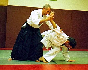 Joint lock - An aikidoka applying a wristlock and armlock combination as a pain compliance hold.