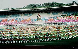 Mass games - 1998 mass games in Pyongyang. The performers are honouring the image of the former North Korean leader Kim Il Sung.