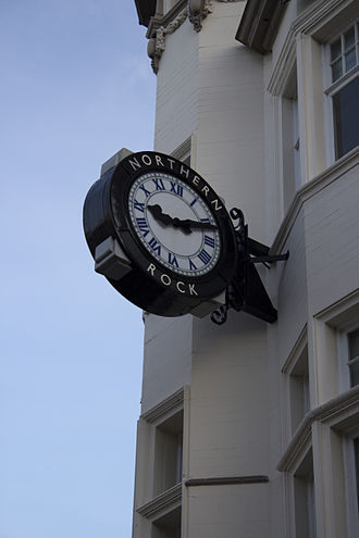 Northern Rock - The clock outside this branch, on Northumberland Street, Newcastle upon Tyne, is emblazoned with the bank's name and has become a popular image in print and television coverage of the Northern Rock crisis. Following the Virgin rebranding this clock still features the name Northern Rock.