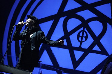 The heartagram (pictured in the background) was created by Valo on his twentieth birthday Nova2013 HIM Ville Valo 0002.JPG