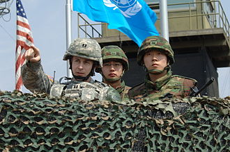 Major non-NATO ally - South Korean soldiers and a U.S. Army officer monitor the Korean Demilitarized Zone in 2008.