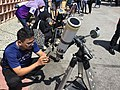 Observing partial solar eclipse with telescope.jpg