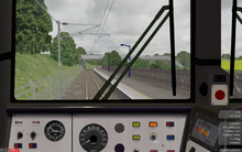 A screenshot of openBVE featuring a view from a locomotive cab.