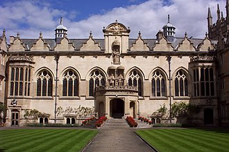 Oriel College, Oxford - East range of the First quad; the ornate portico in the centre leads into a hall, the doors on either side lead to the undercroft (left) and chapel (right).
