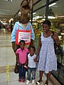 Owen's wife Margret, Wilson & Vanessa introduced to a bookshop in SA Easter 2012.jpg