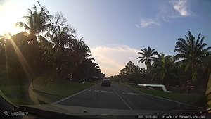 Painted road reference sign at Teluk Kerang-Penerok boundary - Mapillary (03zUx6kGS0JTh0yHrKkswv).jpg