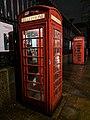 Pair Of K6 Telephone Kiosks Next To The Western Stone Pier On Front Boundary Railings, British Museum, London.jpg