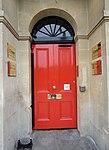 Panelled red door in Bath, Somerset, England.jpg