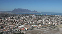 An aerial view of Parklands with Table Mountain in the background.