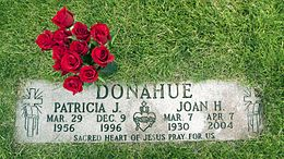 A flat gravestone with a bouquet of roses