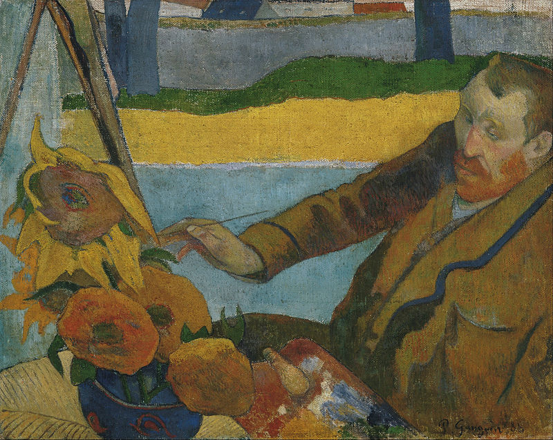 A seated red-bearded man wearing a brown coat, facing to the left, with a paintbrush in his right hand, is painting a picture of large sunflowers.