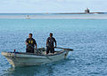 Pearl Harbor base personnel retrieve tsunami debris. (13132486845).jpg