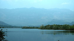Pechiparai Dam, with a scenic view of the Western Ghats.JPG