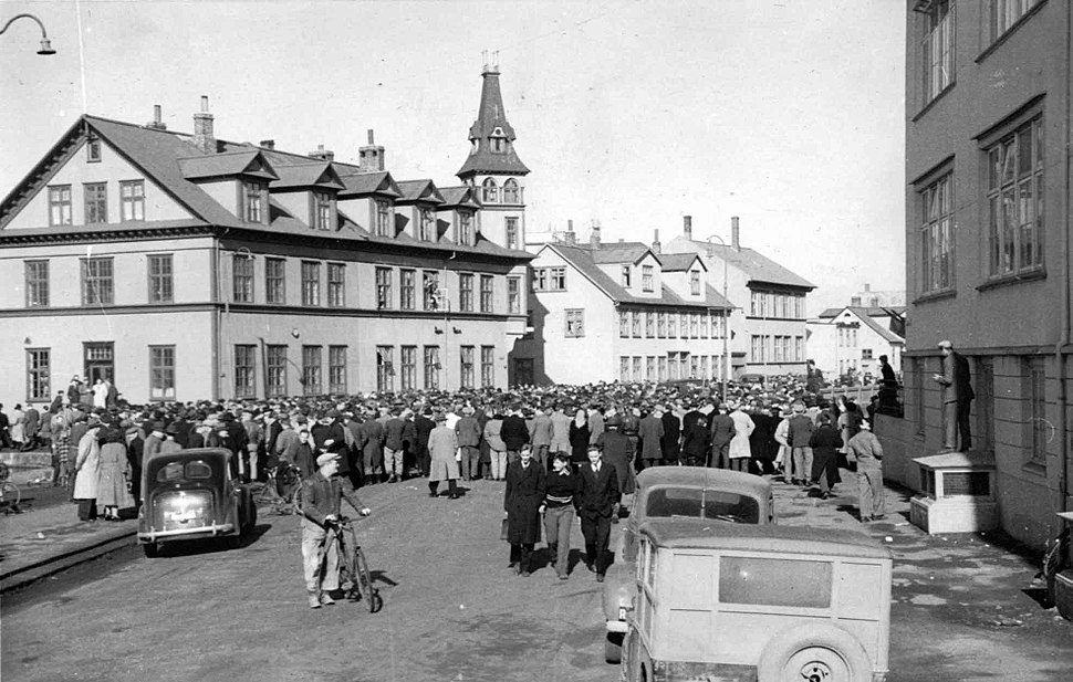 People gather for a meeting at the old school, by Tjörnin in downtown Reykjavik.