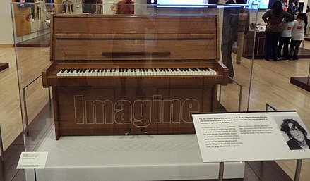 "The Steinway piano that Lennon used to compose the song ""Imagine"" on exhibit in the Artist Gallery of the Musical Instrument Museum in Phoenix, Arizona Phoenix-Musical Intrument Museum-John Lennon exhibit.jpg"