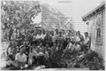 """Photograph with caption """"Personnel, U.S. Engineer Field Office, Dam No. 8."""" - NARA - 282384.tif"""
