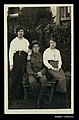 Photographic postcard of an Australian soldier with two women (10301396704).jpg