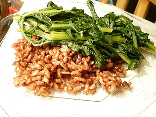 Plate of Wehani rice with sauteed dandelion greens