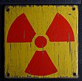 "Polish ""warning - radiation"" sign on wooden plate.jpg"