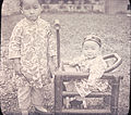 Portrait of child and baby sitting in an infant chair, Changde, Hunan, China, ca.1900-1919 (IMP-YDS-RG008-358-0008-0067).jpg