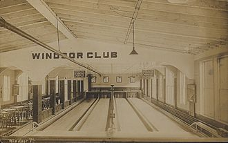 Candlepin bowling - An early 20th century four-lane candlepin alley in Windsor, Vermont, United States, about 1910—note also the presence of stored tenpins and duckpins on a shelf behind the pit areas.