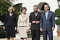 President George W. Bush and Laura Bush welcome the Prince of Wales and Duchess of Cornwall to the White House.jpg