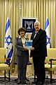 President Reuven Rivlin, receiving the annual report of the Bank of Israel 2014 from the Governor of the Bank of Israel Dr. Karnit Flug. March 31, 2015. I.jpg