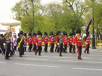 King's Guard (Thailand) - Image: Princess Sirindhorn follow the royal chariot in the royal funeral procession of Princess Bejaratana Rajasuda