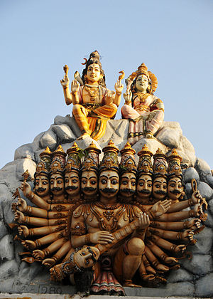 Ravananugraha - Ravana places his head-veena beneath Kailash as Shiva and Parvati sit atop it.